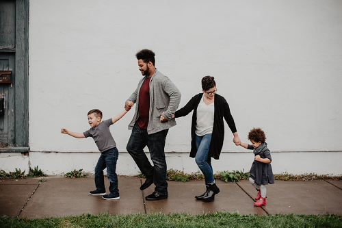 a family walking together in rain boots